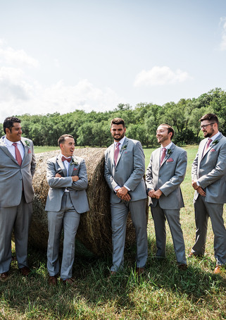 deer-ridge-estate-groomsmen-hay.jpg