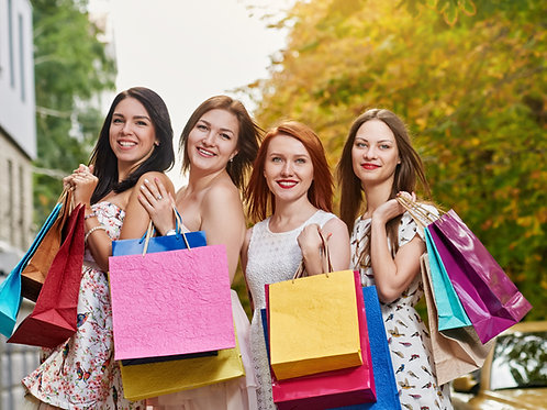 Four-Happy-Women-Shoppers-Smiling-and-Holding-Bags-Family-in-New-York-Tours