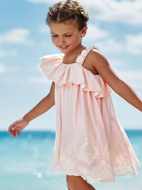 Ruffled dress with flower and embroydered accent