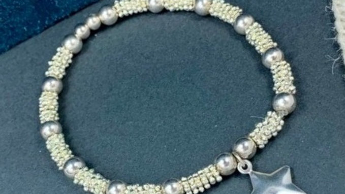 Sterling silver 6mm Daisy Beaded Stacking Bracelet with frosted star charm