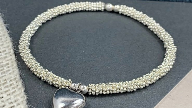 Sterling silver 6mm Daisy Beaded Stacking Bracelet with Puff star charm