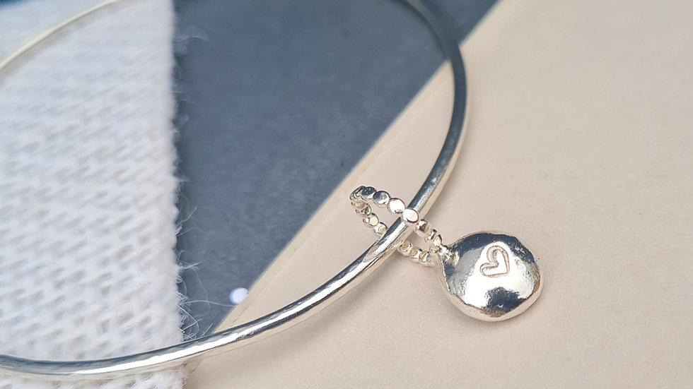 Sterling Silver Pebble charm Bangle with added hand stamped heart.