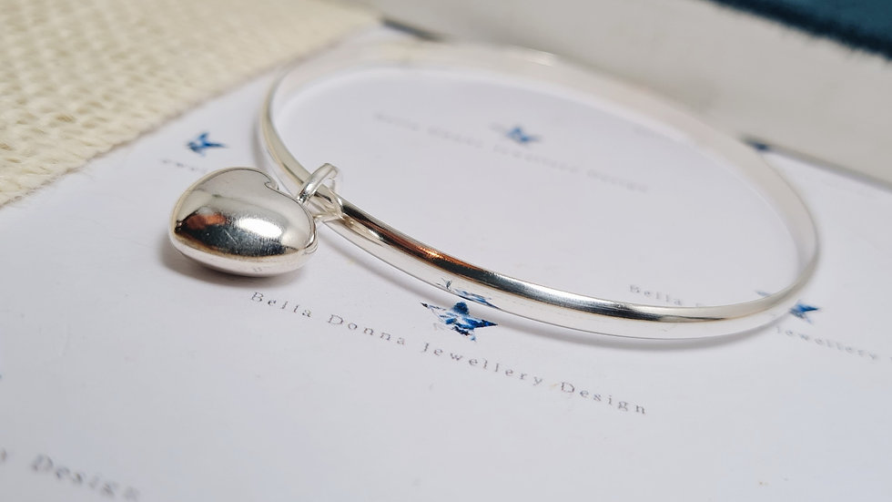 Sterling Silver D shaped wire bangle with chunky puff heart charm.