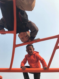 Two students playing on the climber