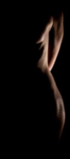 Light sculpts the edge of a models body in our Cincinnati studio
