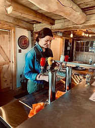 Woman pouring cider at a bar