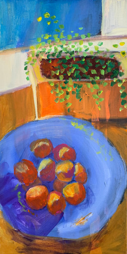 tangerines in blue bowl