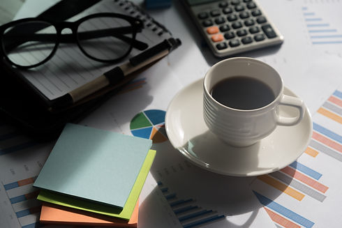 Office desk table with coffee cup, glass