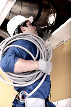 Electrician wiring an industrial loft space_edited.jpg