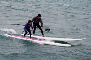 Taku Araki and his son Shiru on an ULI Board inflatable SUP learning to downwind paddle.
