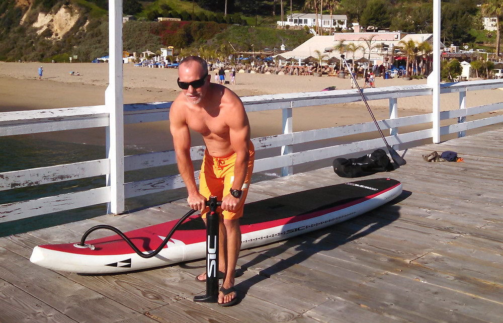 Inflating the SIC X12.6 Air Glide inflatable SUP.