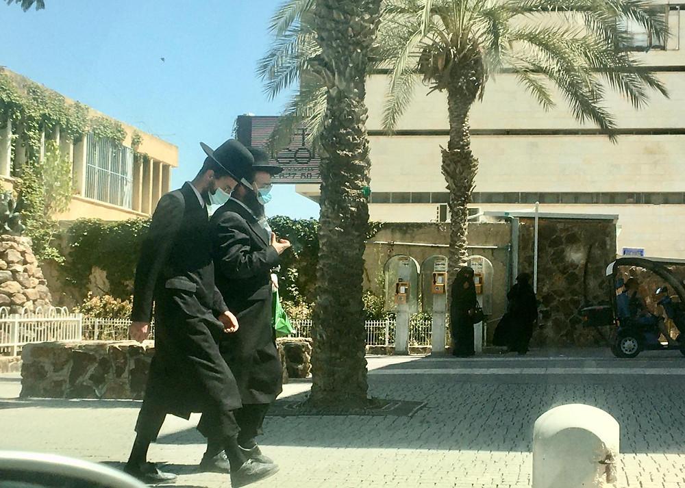 Dati'im (black hats) walking in the Negev