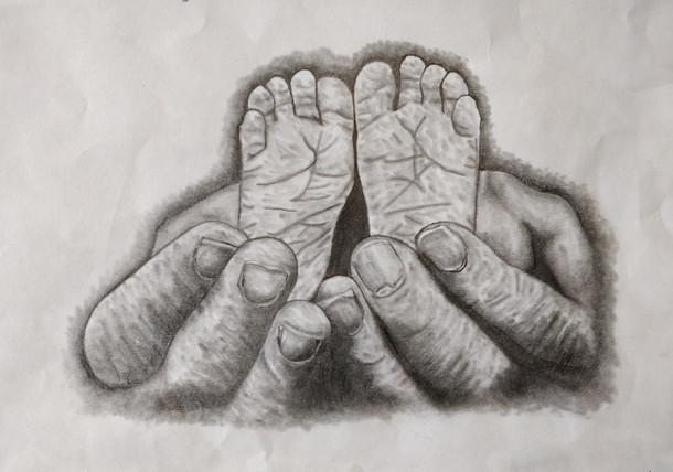 Study of a baby's feet and a father's hands