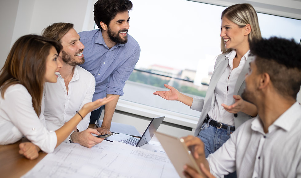 cheerful-coworkers-in-office-during-comp