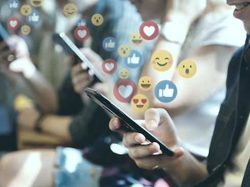 People interacting with social media using their mobile phones