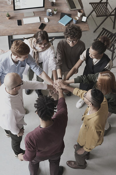 Team stacking hands to show unity and trust