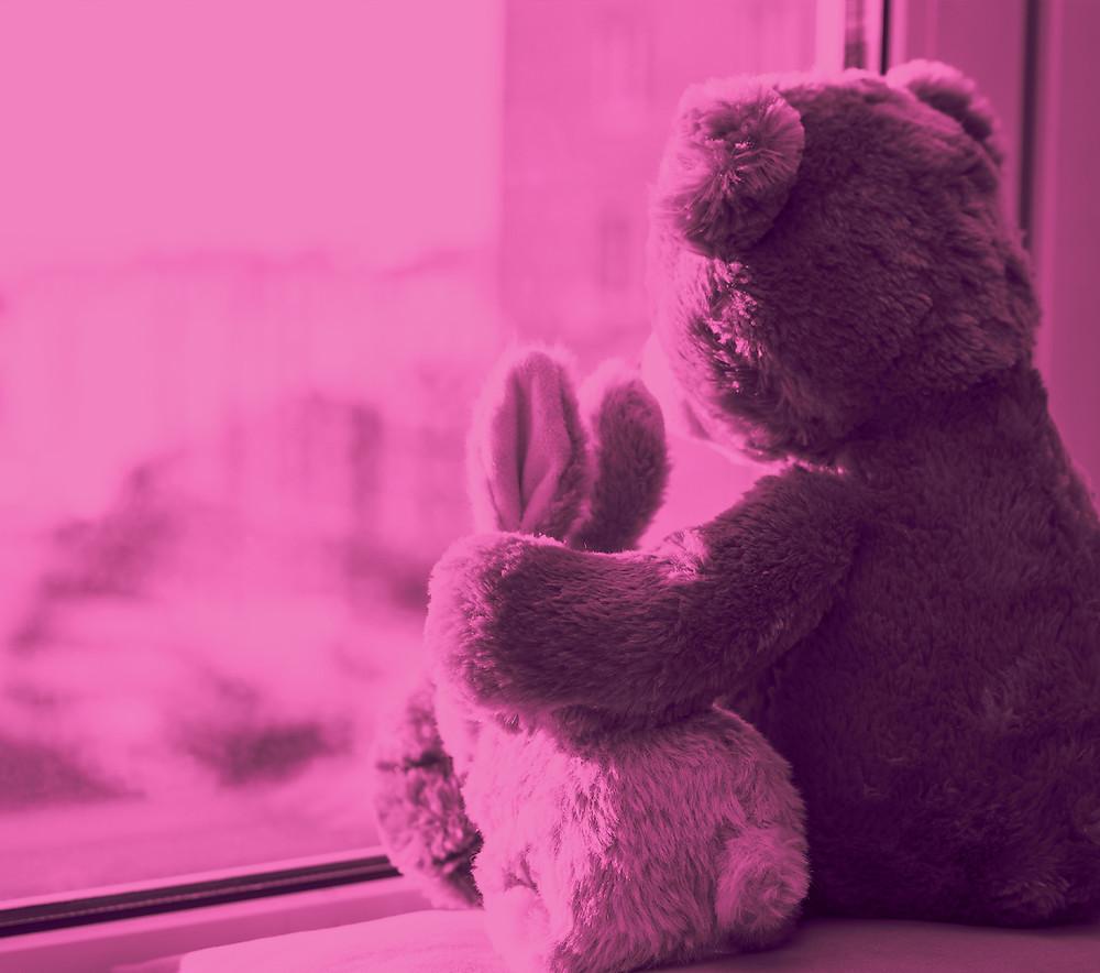 Teddy bear giving a warm fuzzy feeling to a rabbit stuff toy