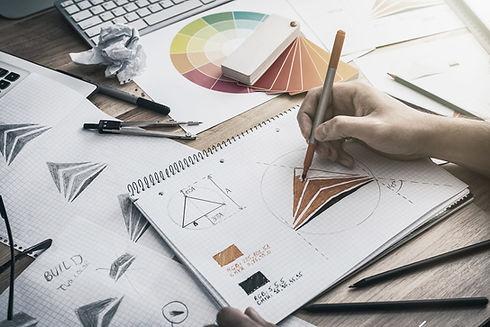 Professional graphic artist designing a logo