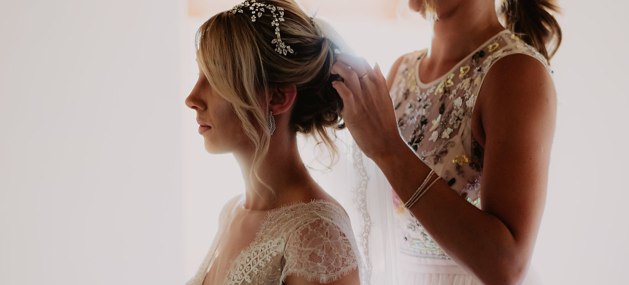 Finishing touches - adding the brides veil