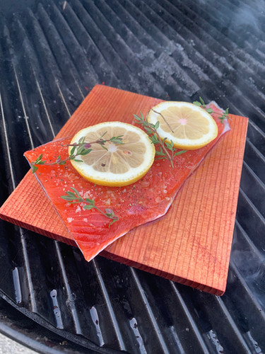 Grilling cedar plank salmon after a day of work.