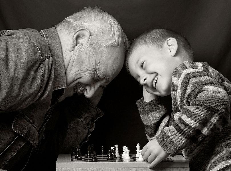 Granddad with grandson on a dark backgro