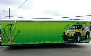 Office Trailer Wrapped with a picture of a green Jeep