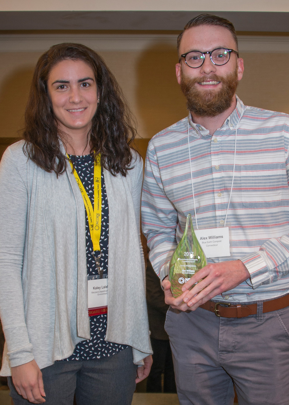 Alex accepting the award from Kaley Laleker from NERC