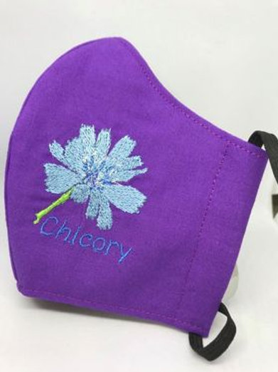Chicory flower on purple fabric
