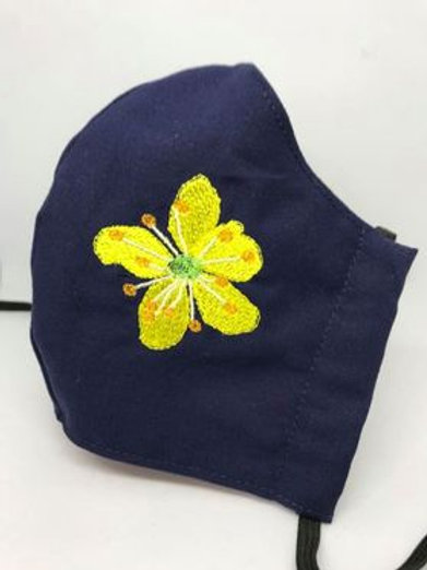 Agrimony flower on navy blue fabric
