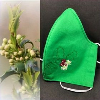 Christmas Holly flower on green fabric