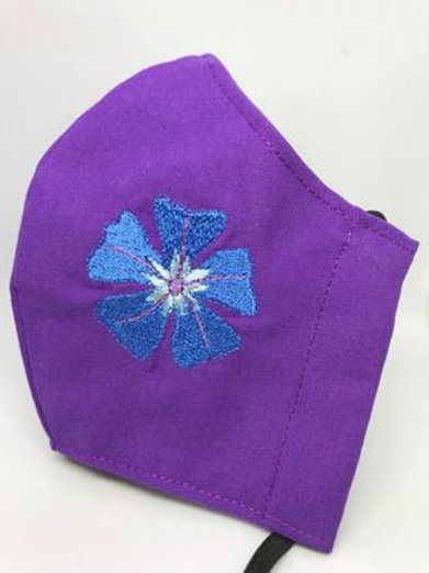 Cerato flower on purple fabric