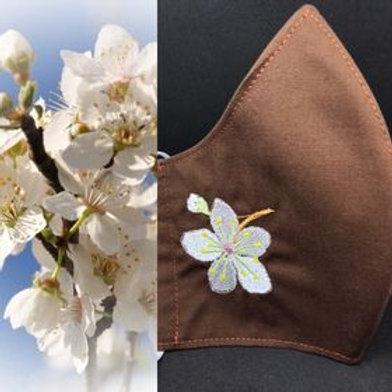 Cherry Plum flower on brown fabric