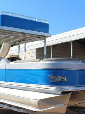blue double decker pontoon with water sl