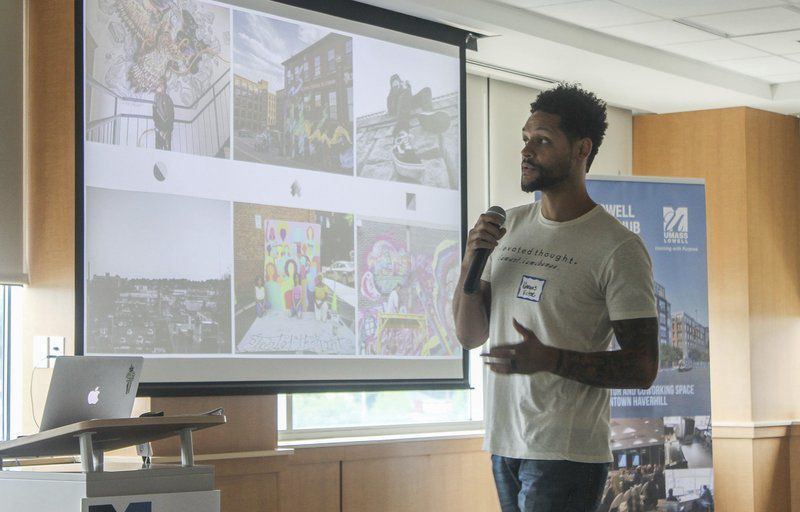 Photo courtesy of Eagle Tribune. Marquis Victor, our executive director, discusses youth-led and created murals in Lawrence to kickoff event for countywide art and culture mapping project.