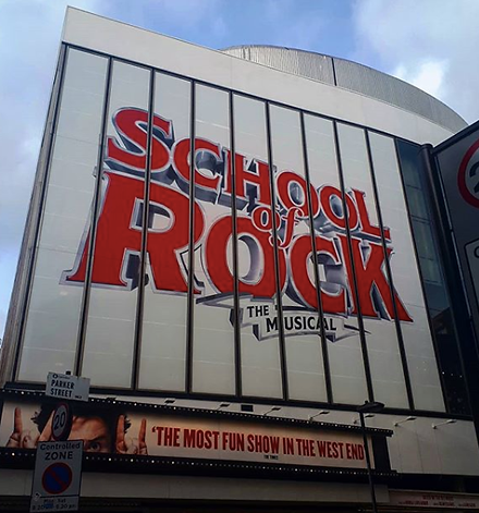 The School of Rock Musical sign on their London Theatre