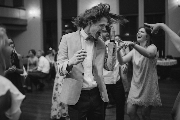 groom dancing with long hair