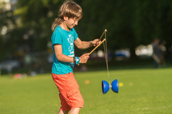 outdoor portrait of young boy playing wi