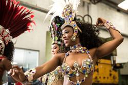 Brazilian woman dancing samba music at c