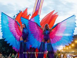 Carnival Colourful Stiltwalkers
