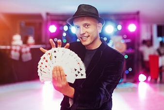 Magician showing trick with playing card