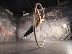 Strong circus performer spinning in the