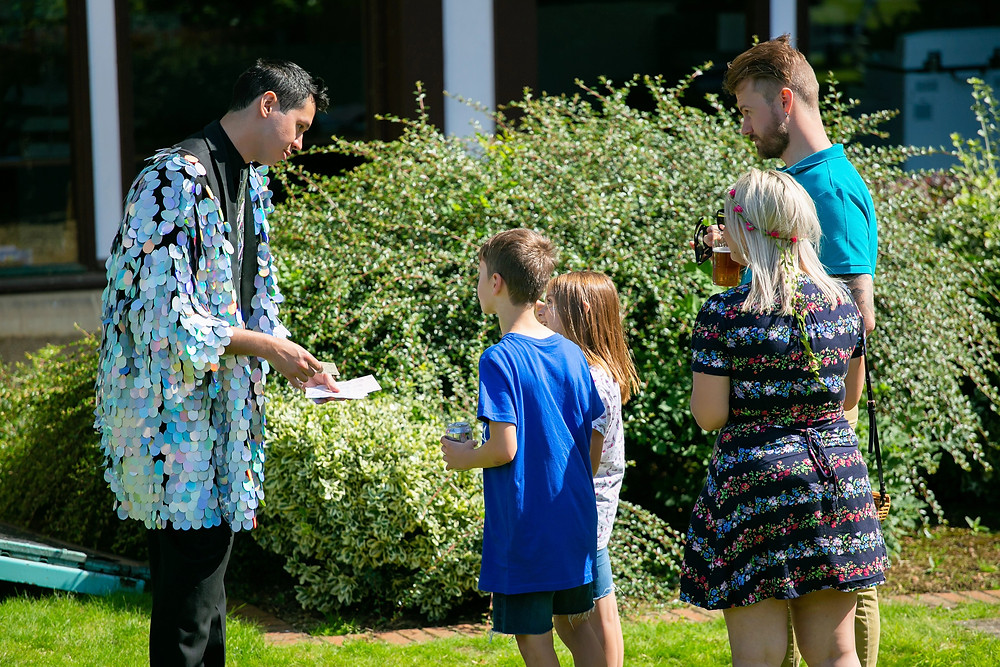 Walkabout magician at corporate summer party