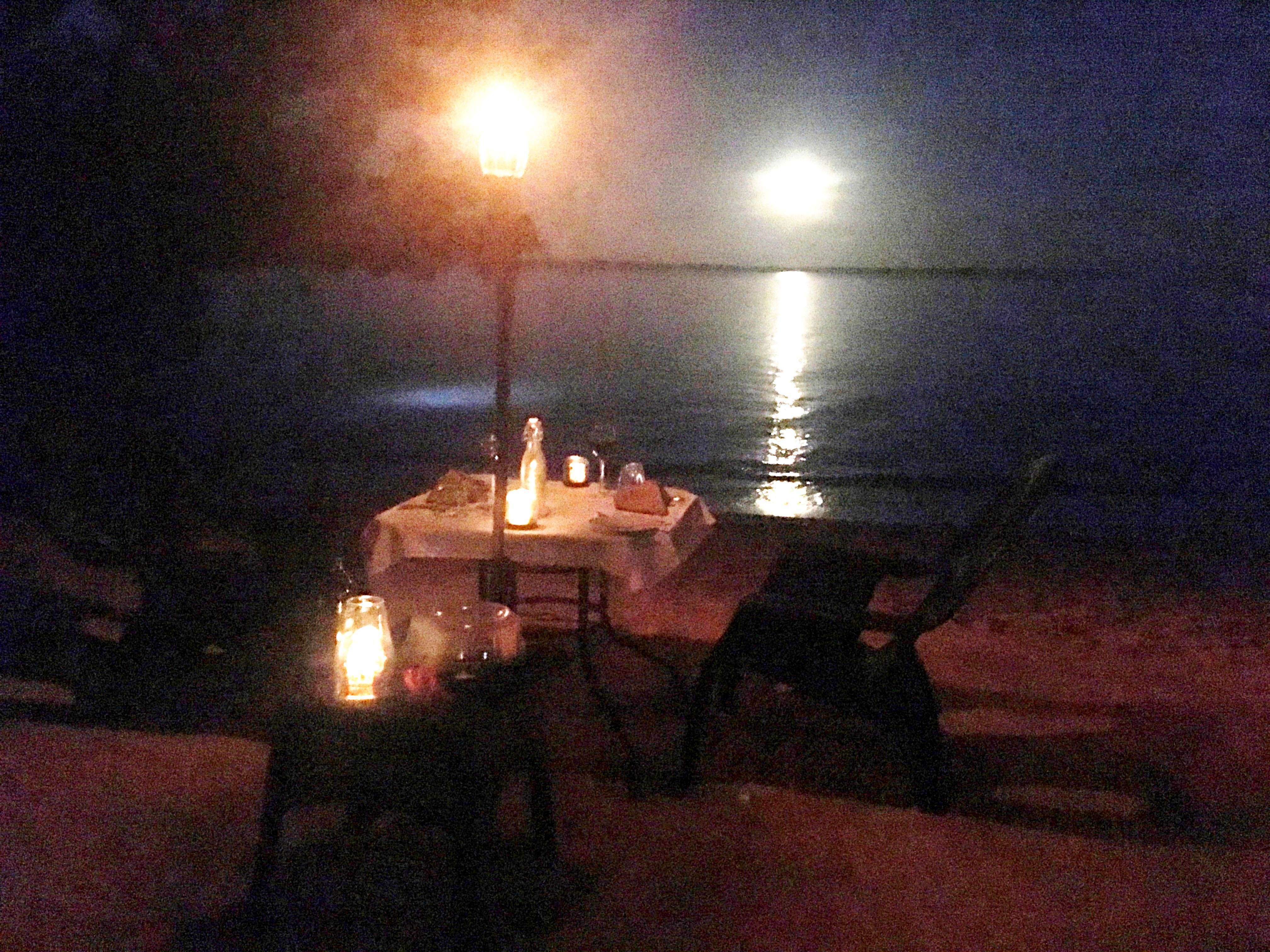 Beach dining by firelight