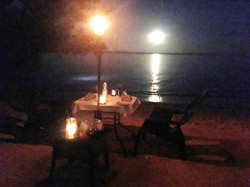 Beach dining by firelight