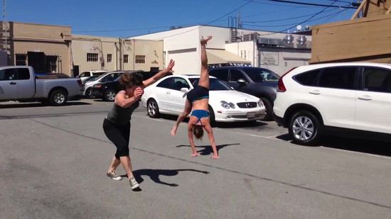 Cartwheels in YHC parking lot with student Jenny