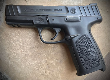 Laser engraved pistols