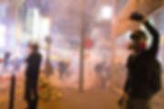 man-wearing-gas-mask-standing-beside-sto