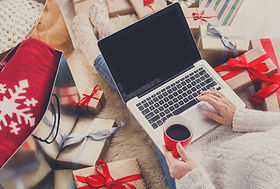 Christmas online shopping top view. Female buyer with laptop, copy space on screen. Woman