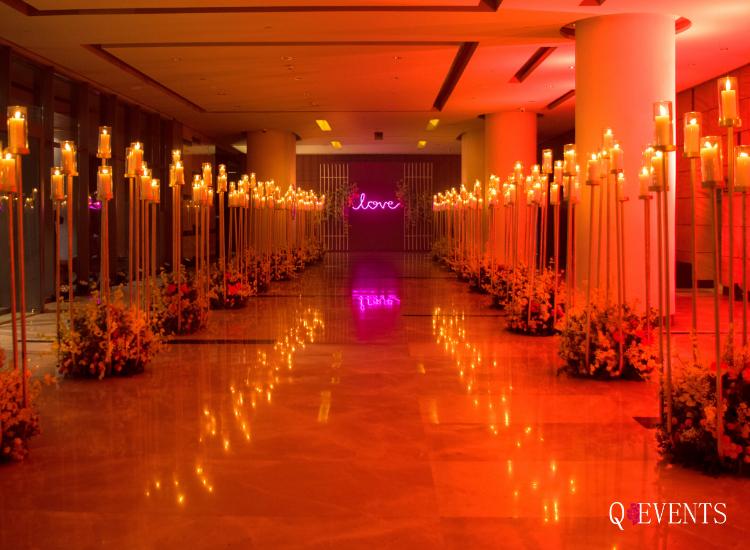 Candle lit walkway for Apurva & Ankit's
