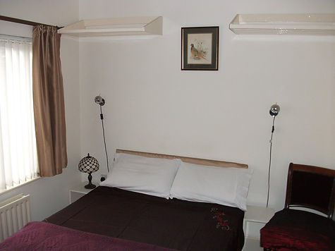 picture of a bedroom in the hotel   motel - Banks of the Faughan Motel